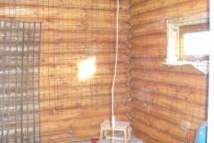 Подготовка стены из бревен к штукатурке с сеткой
